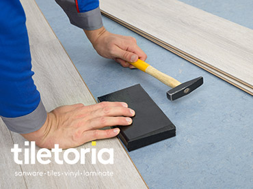 How to install a laminate floor - tapping block and hammer